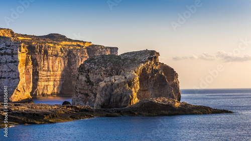 Fototapeten Gozo, Malta - The famous Fungus rock on the island of Gozo at Dwejra bay at sunset