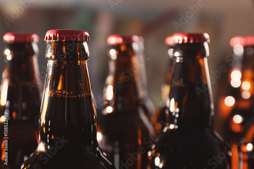 Bottles of beer on blurred background Tapéta, Fotótapéta