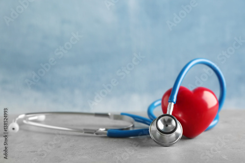 Fotografie, Obraz  Stethoscope and red heart on table