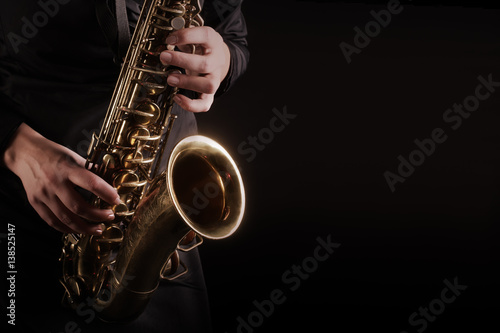 Foto auf Leinwand Musik Saxophone player Saxophonist playing jazz music instruments