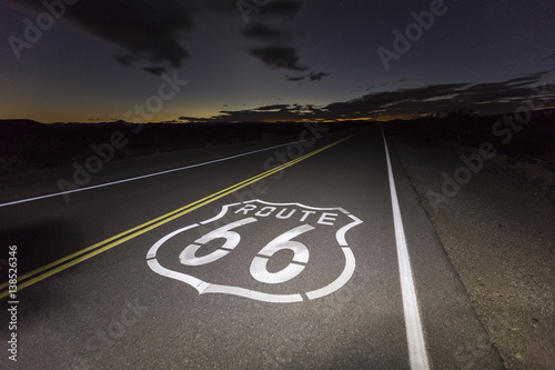 Photo Stands Route 66 Route 66 pavement sign in the California Mojave desert night.