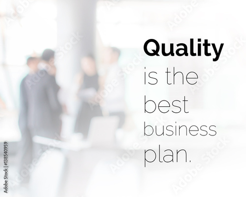 Inspirational quote on blurred business work space background with vintage filter