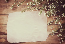 White Flower On Grunge Wood Board And Paper Background With Space.