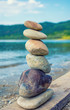 Photo of stones balanced on top of eachother on a beach