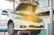 Car maintenance servicing mechanic pouring new oil