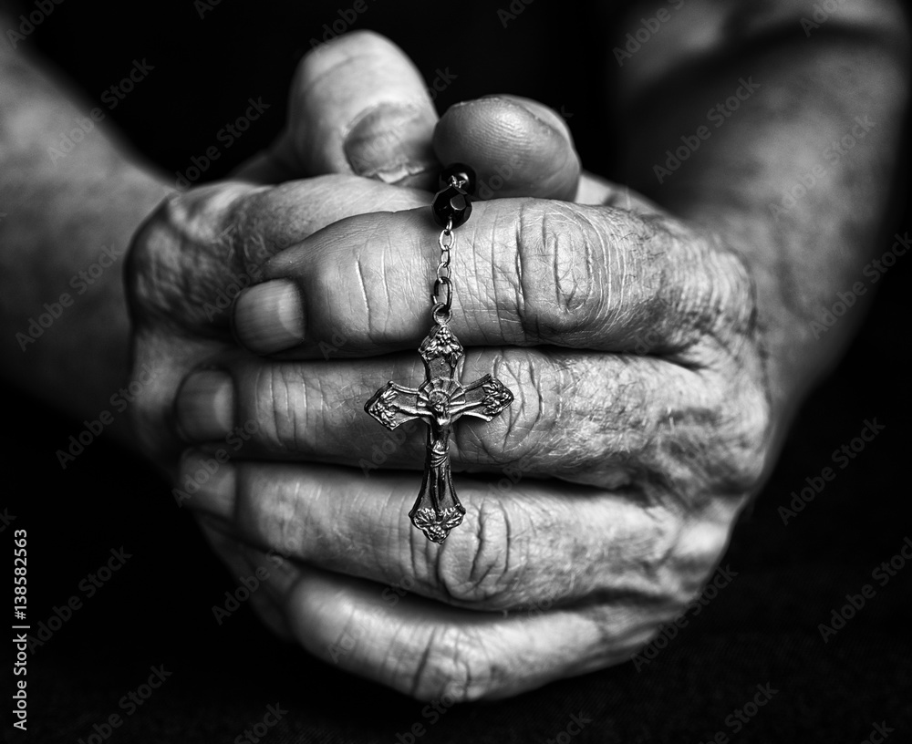 Fototapety, obrazy: Rosary in closed hands of senior. Black and white photography
