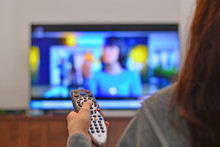 Women Watching Tv And Use Remo...
