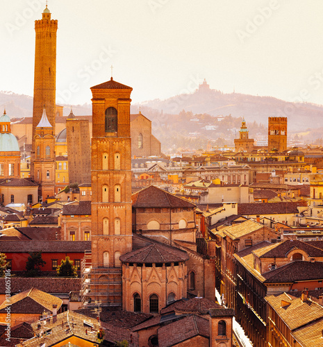 Photo Bologna, cityscape with towers and buildings, San Luca Hill in background