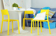 Modern room interior with yellow chairs