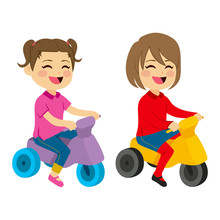 Cute Little Child Baby Boy And Girl With Toy Motorcycle Riding