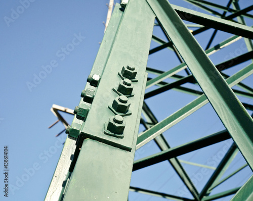 Fotografie, Obraz  Detail of the electric pylon green with bolts.