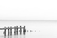 Seascape Tranquil Background With Room For Text, Rustic Pier Posts In Lower Left Of Water