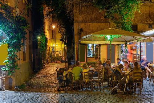 Obrazy na płótnie Canvas Night view of old street in Trastevere in Rome, Italy