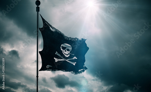 Keuken foto achterwand Schip ripped tear grunge old fabric texture of the pirate skull flag waving in wind, calico jack pirate symbol at cloudy sky with sun rays light, dark mystery style, hacker and robber