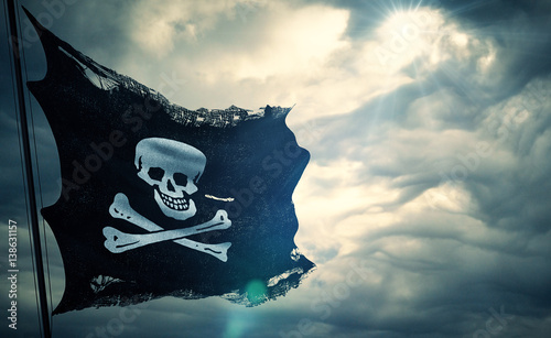 Valokuva  ripped tear grunge old fabric texture of the pirate skull flag waving in wind, c