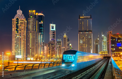 Self-driving metro train with skyscrapers in the background - Dubai, UAE