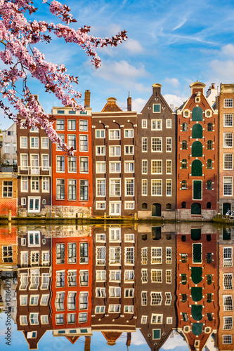Fototapeta Amsterdam  traditional-old-buildings-in-amsterdam-spring-the-netherlands