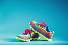 Colorful Running Sneakers On A Blue Background