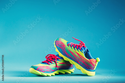 Fotografía  Colorful running sneakers on a blue background