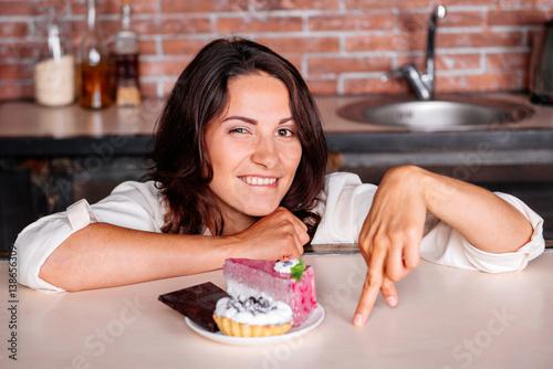 Foto op Canvas Kruidenierswinkel Woman on the diet wants to eat cake. Diet concept