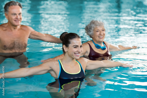 People exercising in pool
