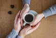 Cup of coffee for Breakfast in the hands of lovers.