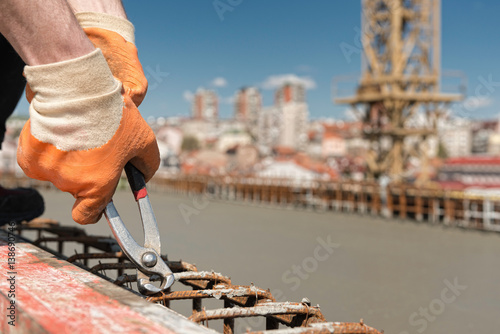 Tightening concrete armature wire mesh - Buy this stock