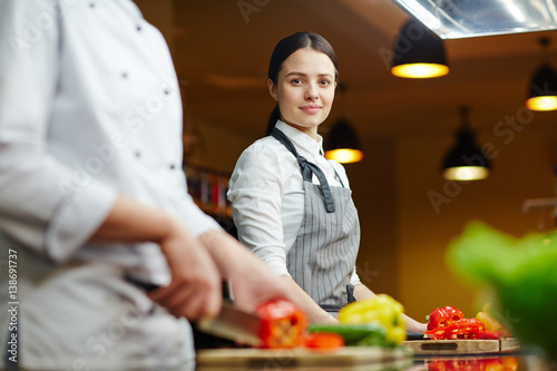 Poster Cuisine Young staff of restaurant cooking vegetables