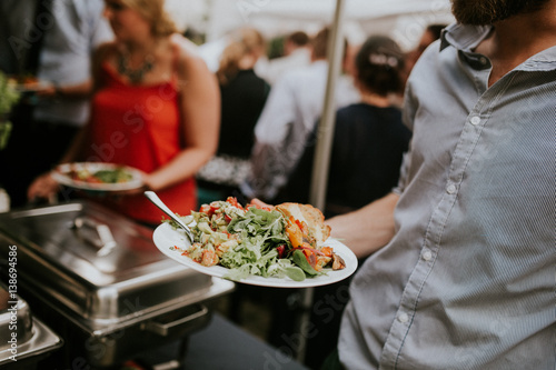 holding plate with salad - 138694586