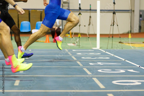 Stampa su Tela Sportsman finishing on sprint race running on track and field competitions