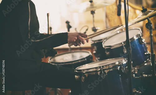 Photo A drummer plays on drums
