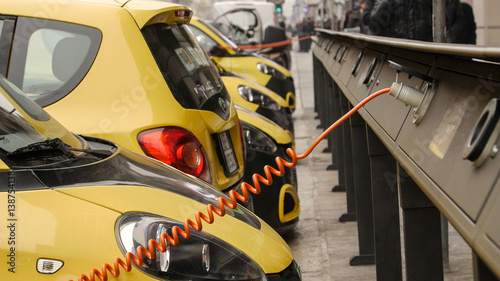 Deurstickers Oude auto s Power supply for electric car charging. City electric car charging station. Close-up.