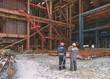 Workers look at the installation of the boiler in the power plant construction