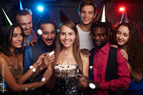 Group photo of dressed-up young people celebrating birthday of their female frie Fototapeta