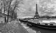 Beautiful panoramic view of the Eiffel Tower and Jena bridge from the river Seine embankment. Dramatic cloudscape. BW photography. Paris, France.