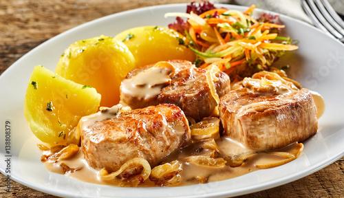 Valokuva  White dish with pork fillet