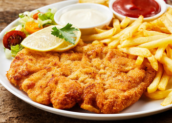 Schnitzel and French fries dish