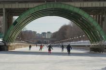 Ice Skating Under The Bridge On The Frozen Rideau Canal Ottawa Winterlude