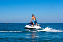 Man Riding A Jet Ski At Sea