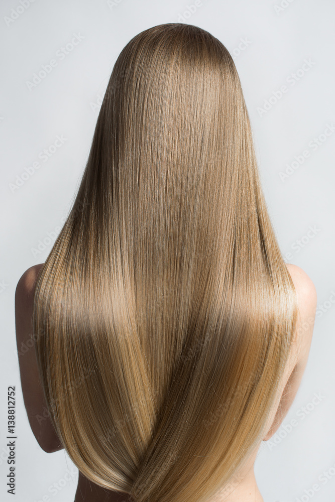 Fototapeta Portrait Of A Beautiful Young Blond Woman With Long Straight Hair. Back View