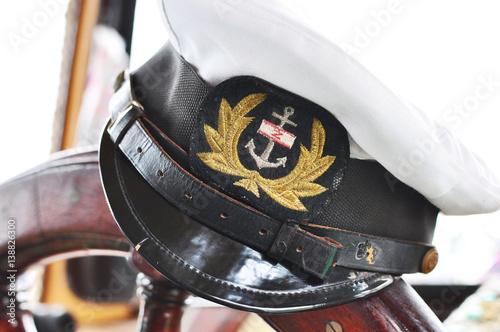 Captain's hat on steering wheel. Wallpaper Mural