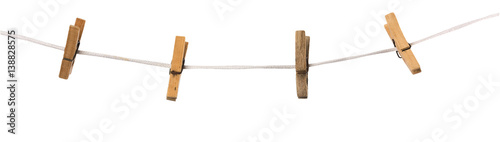 Fotografie, Obraz  Old wooden clothespins on a rope isolated on  background