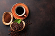 Coffee cup, beans and ground powder