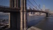 sunny rising shot of Brooklyn Bridge with downtown NYC skyline in background