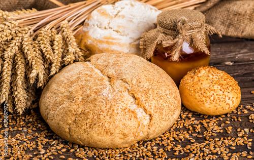 Vászonkép Assortment of baked bread on wooden table background