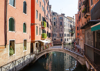 View of water street in one of Venice Canals and old colorful buildings, Venice, Italy