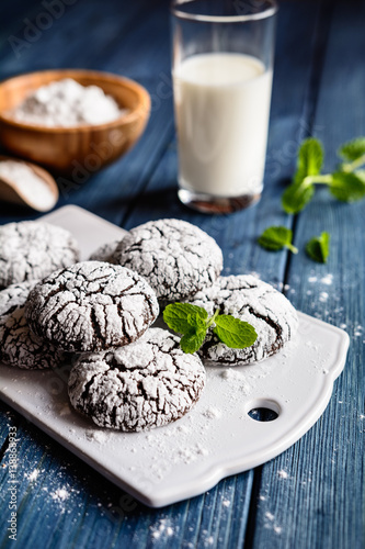 Fotografia, Obraz  Chocolate crinkle cookies with powdered sugar icing