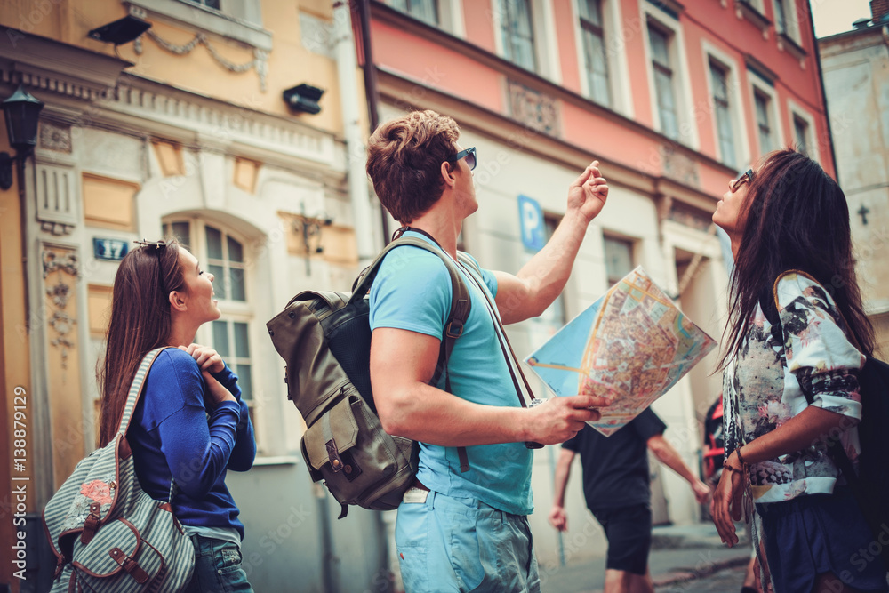 Fototapety, obrazy: Multi ethnic friends tourists with map in old city