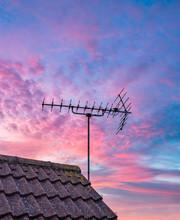 TV Antenna With Sunset Sky