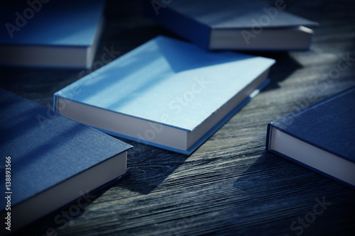 Fotografering  Books on grey wooden table